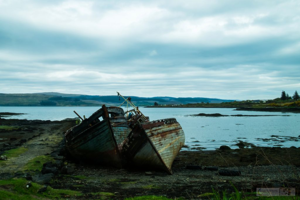 Visual storytelling; Two stranded and rotting fishing vessels on the shores of the Sound of Mull, near Salen on the Isle of Mull in the highlands and islands of western Scotland on Mallory on Travel adventure travel, photography, travel Iain Mallory_Scotland 001