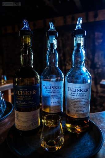 Three whiskies for the tasting session at the Talisker distillery in Carbost under the Cuillin Ridge on the Isle of Skye, on the west coast of Scotland on Mallory on Travel adventure travel, photography, travel Iain Mallory_Scotland 001-11