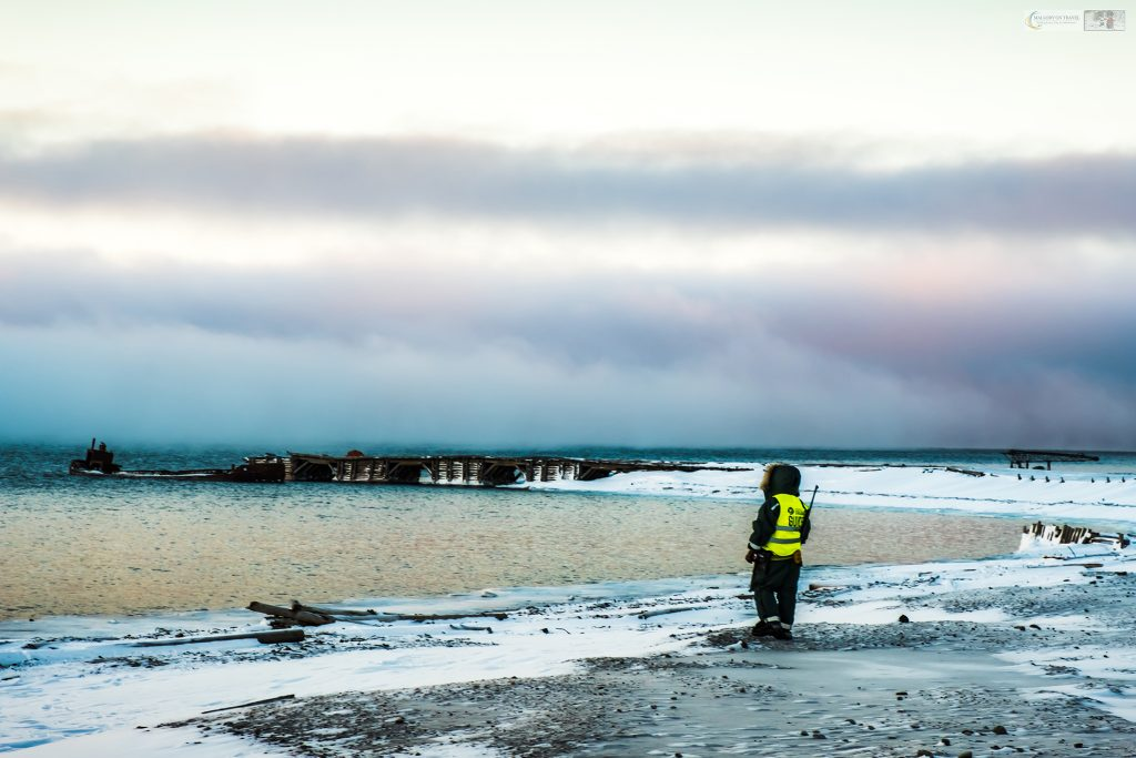 Guide watching for polar bears with a rifle at Colesbukta, the Russian 'ghost town' on the island of Spitzbergen, the Norwegian archipelago of Svalbard on Mallory on Travel adventure travel, photography, travel Iain Mallory_Svalbard-1-68