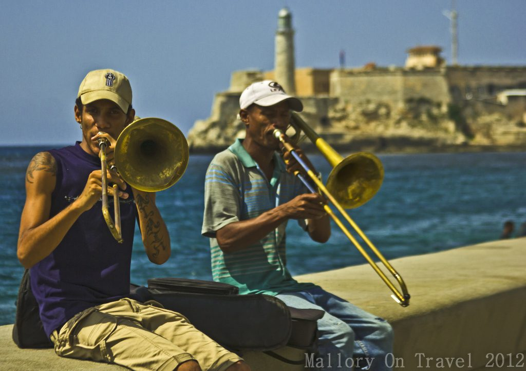 Lighthouses of the World; Musicians on the malecon of Havana on the Caribbean island of Cuba with the lighthouse in the background on Mallory on Travel adventure travel, photography, travel Iain Mallory-300-176