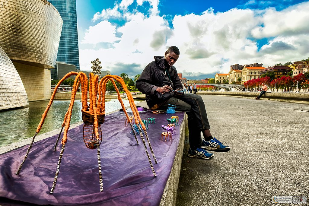 An artisan craftsman selling goods outside the Guggenheim Museum, Bilbao in the Basque Country, one of the four regions making up Green Spain on Mallory on Travel adventure travel, photography, travel Iain Mallory_Spain 001