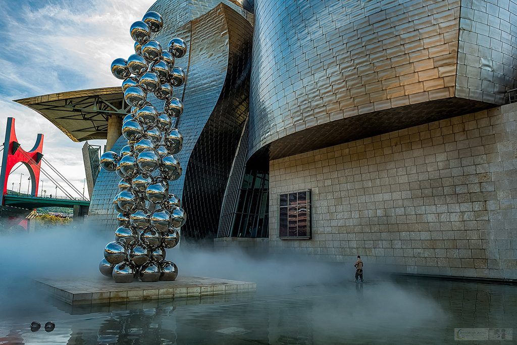 A janitor cleaning outside the Guggenheim Museum on the Nervion River in Bilbao, unofficial capital of the Basque Country, northern Spain on Mallory on Travel adventure travel, photography, travel Iain Mallory_Spain 014-2